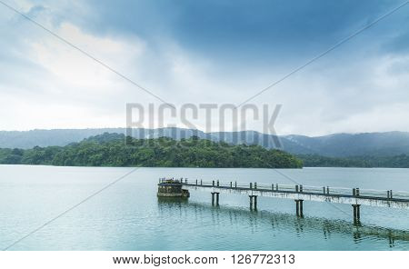drizzling rain in the reservoir - blue sky over the river- bridge in the water -Kerala