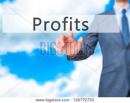 Profits - Businessman Hand Pressing Button On Touch Screen Interface.