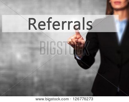 Referrals - Businesswoman Hand Pressing Button On Touch Screen Interface.