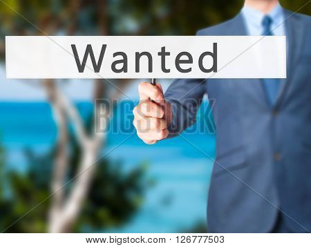 Wanted - Businessman Hand Holding Sign