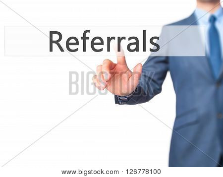 Referrals - Businessman Hand Pressing Button On Touch Screen Interface.