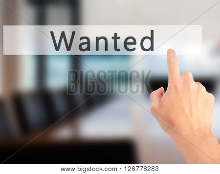 Wanted - Hand Pressing A Button On Blurred Background Concept On Visual Screen.