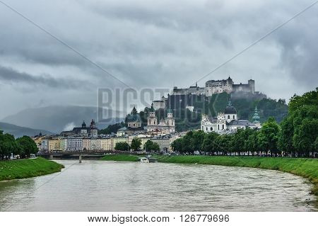 Beautiful view of Salzburg with Festung Hohensalzburg and Salzach river in rainy summer day, Salzburg, Salzburger Land, Austria
