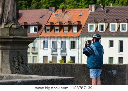 Man Taking Pictures On The Bridge In Wurzburg, Germany