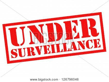 UNDER SURVEILLANCE red Rubber Stamp over a white background.