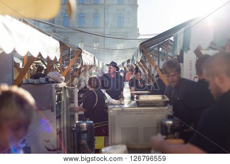 Ljubljana, Slovenia - April 10: People enjoing outdoor street food festival of Pivo and burger, Beer and Burger event, on April 10th, 2016 in Ljubljana, Slovenia.