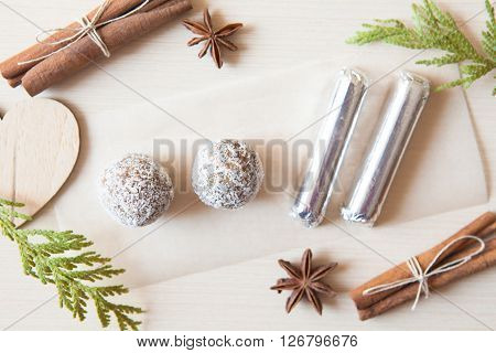 Raw Candies Made Of Date Fruit,nuts,cocoa,coconut Decorated With Cinnamon Sticks,cardamom,thuja Bran