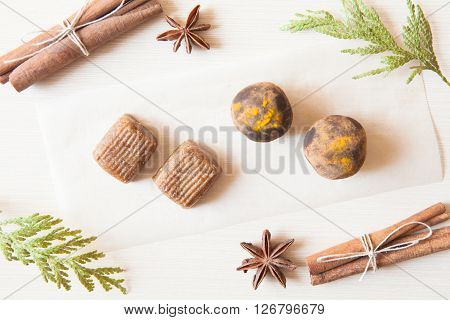 Raw Candies Made Of Date Fruit,nuts,curry,cocoa Decorated With Cinnamon Sticks,cardamom,thuja Branch