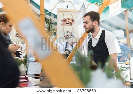 Ljubljana, Slovenia - April 15: People enjoing outdoor street food festival of Odprta kuhna, Open kitchen event, on April 15th, 2016 in Ljubljana, Slovenia.