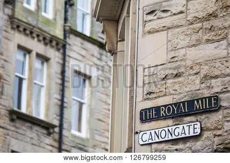 The street signs for Canongate and The Royal Mile in the historic city of Edinburgh Scotland.