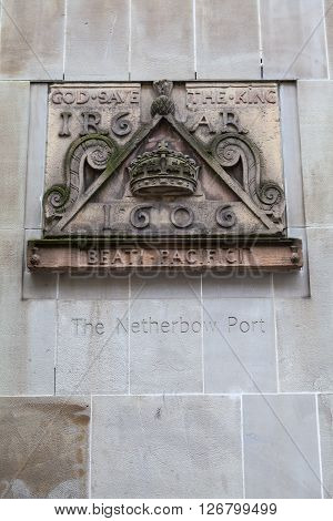 One of the old signs from Netherbow Port which once stood on the Royal Mile in Edinburgh. The sign is now displayed on the exterior of the Scottish Storytelling Centre on the Royal Mile.