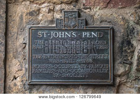 A plaque on St. John Street in Edinburgh detailing the history of the area.