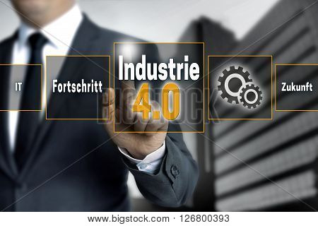 Industrie 4.0 in german industry touchscreen is operated by businessman background.