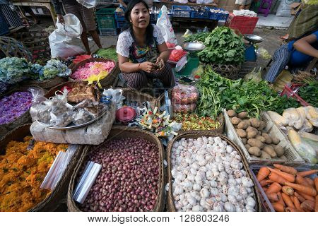 BALI, INDONESIA - MARCH 16, 2016: Commercial activities in the main Ubud market in the morning, shows florist selling flower products. Agricultural produce comes direct from the farmers here in Bali.