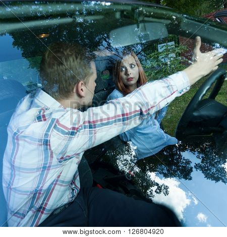 Man shouting at female driver in a car