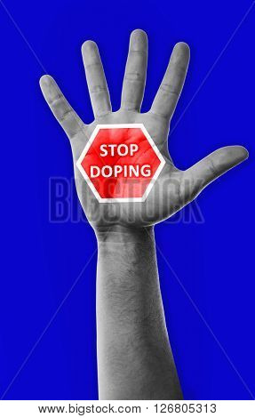 Stop doping concept. Male hand with sign on blue background