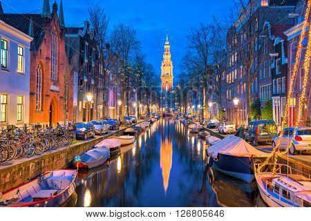Amsterdam Canals With Bridge And Typical Dutch Houses In Netherlands