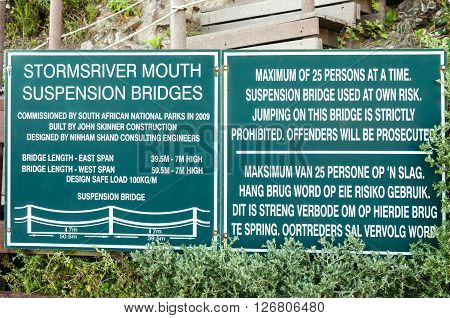 STORMS RIVER MOUTH SOUTH AFRICA - FEBRUARY 28 2016: Information boards for two of the three suspension bridges at the mouth of the Storms River
