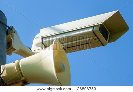 Surveillance Camera with siren on a pole