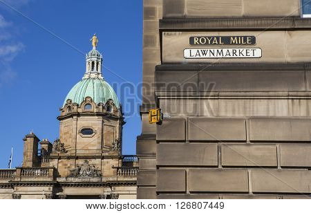 EDINBURGH SCOTLAND - MARCH 10TH 2016: A street sign for the Royal Mile in Edinburgh with the exterior of the Bank of Scotland in the background on 10th March 2016.