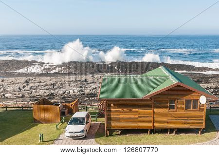 STORMS RIVER MOUTH SOUTH AFRICA - FEBRUARY 29 2016: A chalet overlooking the Indian Ocean at Storms River Mouth Rest Camp