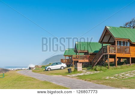 STORMS RIVER MOUTH SOUTH AFRICA - FEBRUARY 29 2016: Chalets overlooking the Indian Ocean at Storms River Mouth Rest Camp