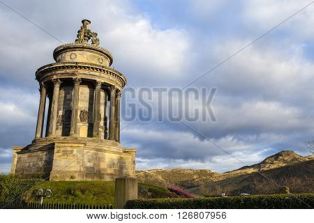 A view of the Burns Monument and Arthurs Seat in the distance in the city of Edinburgh.