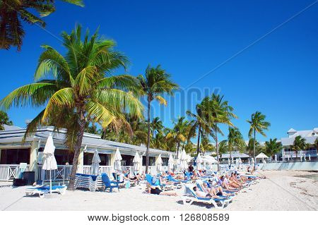 KEY WEST, UNITED STATES - FEBRUARY 6: People relax at the sunny South Beach of Key West near Atlantic Ocean on 6th of February, 2016 in Key West.