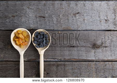 Tasty Small Raisins On A Wooden Spoon