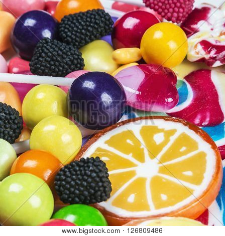 multicolored lollipops candy and chewing gum background