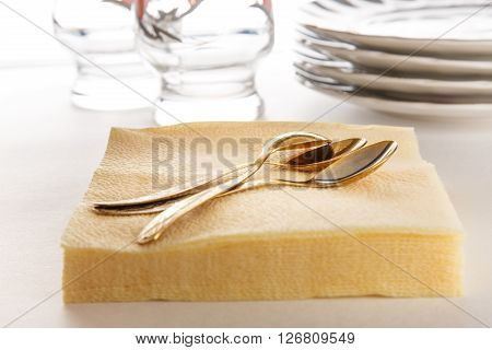 Paper Napkins With Spoons, Plates And Glasses