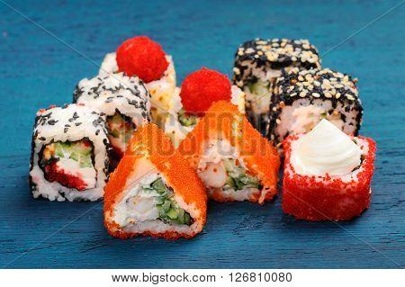 Set of various japanese fusion rolls closeup horizontal