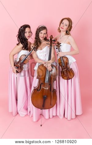 String trio portrait on the pink background