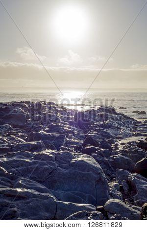 beautiful soft waves break on the rocks on sunset ballybunion beach in ireland