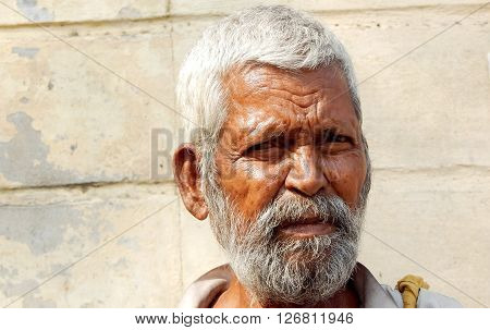 HYDERABAD,INDIA-APRIL 22:Closeup portrait of poor Indian man seeking help outdoors on busy road on April 22,2016 in Hyderabad,India
