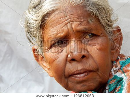 HYDERABAD,INDIA-APRIL 22:Closeup portrait of poor Indian woman seeking help outdoors on busy road on April 22,2016 in Hyderabad,India