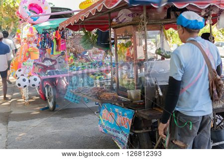 Rayong Thailand - December 31 2015 : Thai exotic food in street food market with grilled chicken. Like the charming people exotic foods greets you on almost every corner in Thailand.