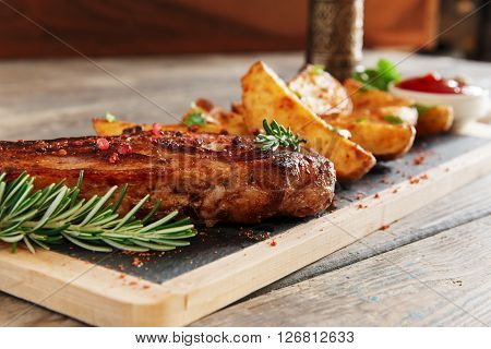 steak on the bone with baked potatoes