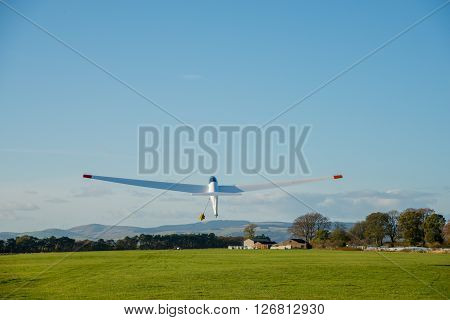 KINROSS SCOTLAND - NOVEMBER 05 2014: A glider being launching at Portmoak Airfield Scotlandwell Scotland.