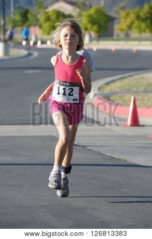 Hemet California/USA-April 17 2016:kid running in the Diamond Valley Triathlon