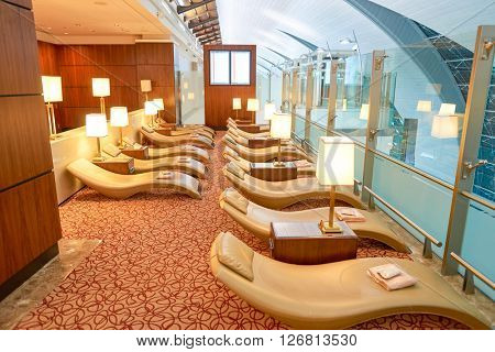 DUBAI, UAE - CIRCA APRIL, 2016: interior of Emirates business class lounge. Emirates is the largest airline in the Middle East. It is an airline based in Dubai, United Arab Emirates.