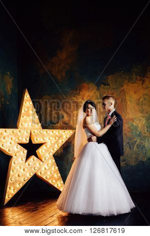 Charming bride and groom on their wedding celebration in an interior.