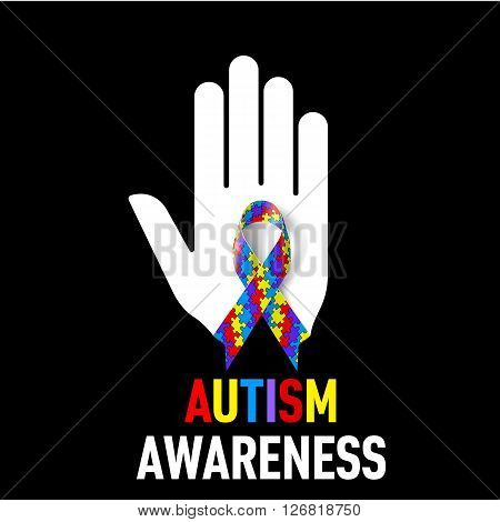 Autism Awareness sign. White hand with puzzle ribbon on black background