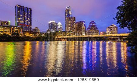 City lights come on in Austin Texas downtown skyline at night