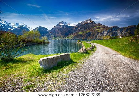 Beautiful Sea Promenade In Sisikon Village With The View Of Swiss Alps And Lucerne Lake, Switzerland
