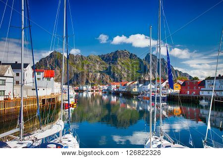 Henningsvaer, Norway - July 21, 2011 - View To Typical Village With Wooden Houses In Henningsvaer, L