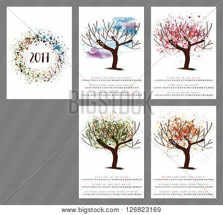 A scalable vector calendar for the year 2017 with a watercolor and vector drawing of a tree changing as the seasons change with four pages and a cover with an abstract texture with copyspace