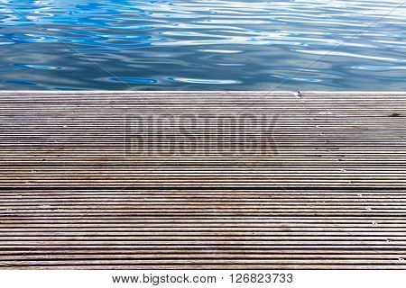 Wooden pier with blue sea in background
