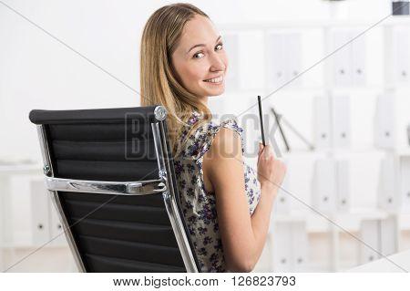 Smiling Girl On Sviwel-chair