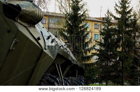 Russian infantry fighting vehicle in the city amid residential buildings